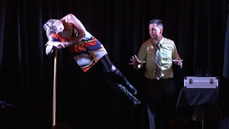 Aaron Paterson levitiates his assistant while performing corporate entertainment for Ontario company Esco Corp.