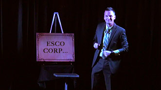 Aaron Paterson performing on stage for Esco Corp with some custom entertainment.