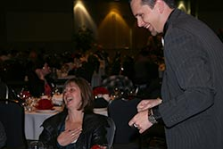 Aaron Paterson, Event Entertainment professional performs close-up magic for a recent Wallenstein Feed event.