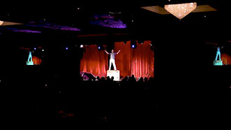 Wide shot of Aaron Paterson performing event entertainment at the WRHBA SAM awards.