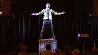 Aaron Paterson magicially appears during performance in Port Hope, Ontario for Esco Corp.