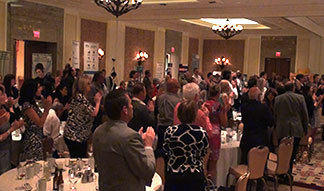 OACC Standing Ovation for Corporate Entertainer Aaron Paterson.