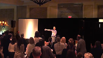 Corporate Entertainer Aaron Paterson performs for OACC and receives a standing ovation.