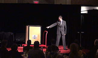 Corporate Entertainer Aaron Paterson performs his origianl illusion for OACC